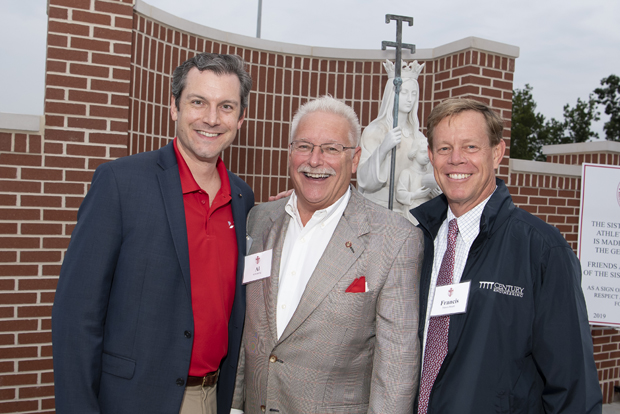 From left, Tyler Tate, P.E., LEED AP, president of Lewis Contractors; Albert W. Rubeling, Jr., FAIA, senior vice president/national architecture practice leader with JMT Architecture; and Francis Smyth, CEO of Century Engineering, Inc., were on hand for the dedication and blessing of the Sisters of Mercy Athletic Complex. (Photo by Larry Canner Photography)