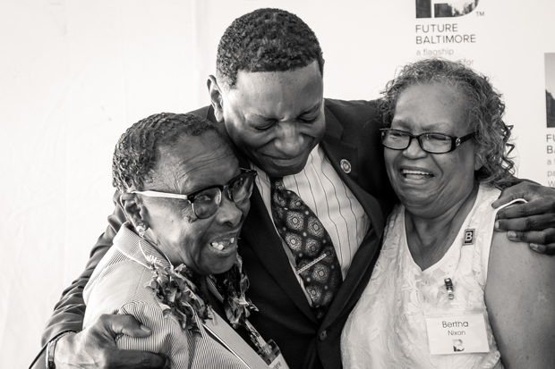 Del. Keith Haynes, D-Baltimore city embraces the neighborhood leaders who sparked the vision for Future Baltimore's Community Resource Center, Bertha Nixon, left, president of the Boyd Booth Neighborhood Association, and Jerlene Boyd, also a member of the association. (Photo courtesy of Future Baltimore)