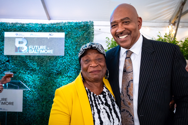 Thelma Terrell, left, a member of the Franklin Square Community Association, gets a photo with Dr. Samuel Ross, chief community health officer with Bon Secours Mercy Health, during the ceremonial groundbreaking event. (Photo courtesy of Future Baltimore)