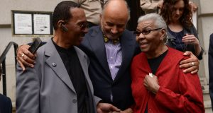"4-2-14 Baltimore, MD- From Left- Walter Lomax; William H. ""Billy"" Murphy, Jr., Walters Attorney; and Carolyn Lomax, Walters sister. Walter Lomax, a 1968 Murder Suspect who was incarcerated  for 39years, at the press conference outside of the Mitchell Courthouse in Baltimore City, after his conviction was vacated and the charge against him dismissed. (The Daily Record/Maximilian Franz)"