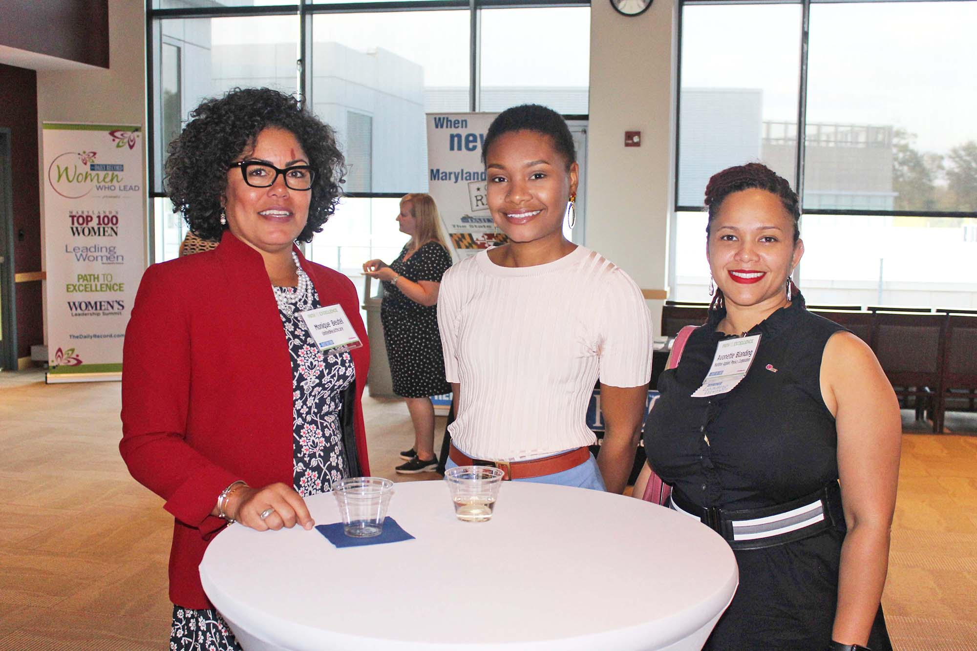 From left, Monique Beutel, United Health Care; Christen Johnson; and Avonette Blanding, Maritime Applied Physics Corporation, chat during the networking event. (Photo by Patrick Brannan)