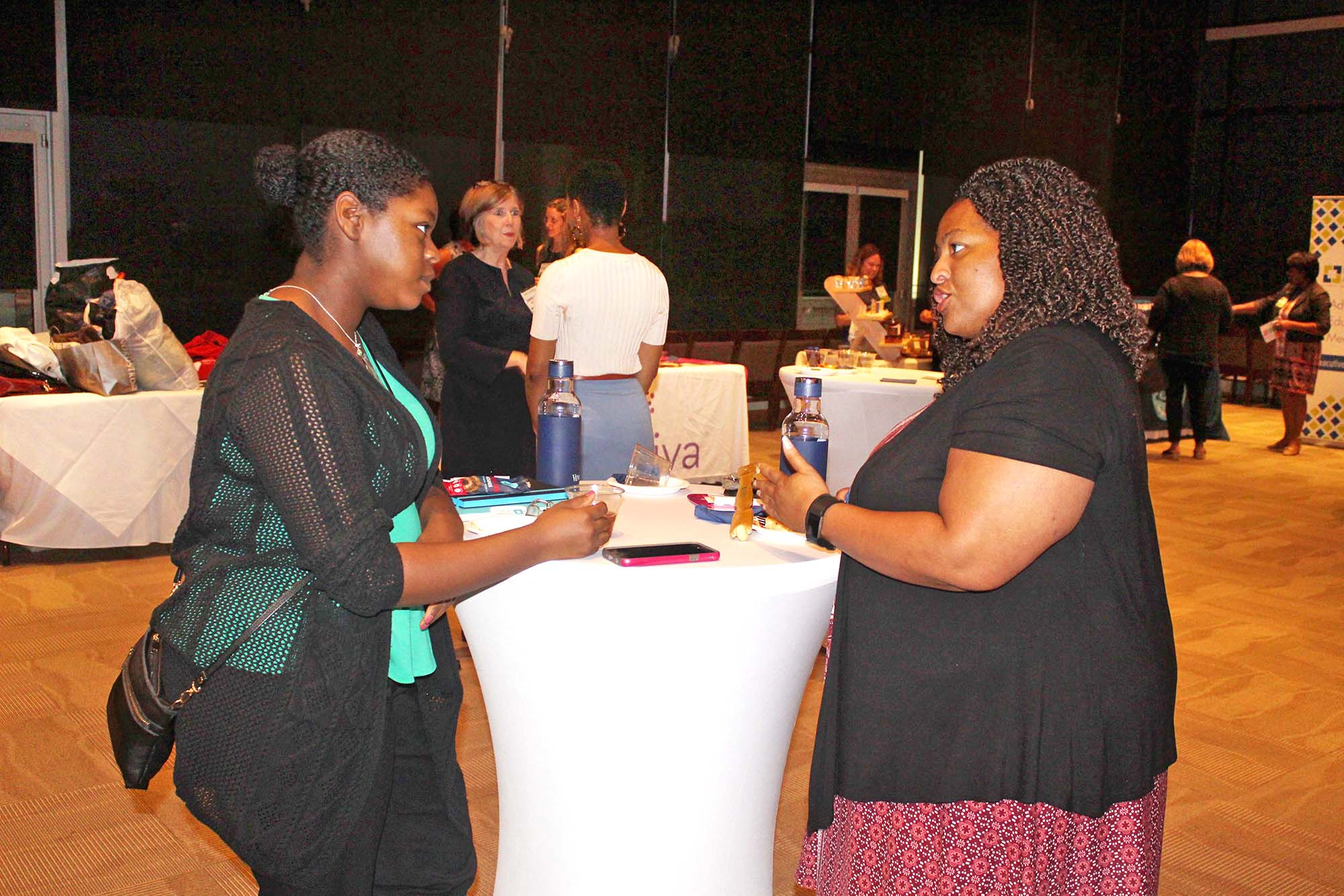 From left, Sharda Smith and Kismet Flagg, Howard Community College, visit during the networking event. (Photo by Patrick Brannan)
