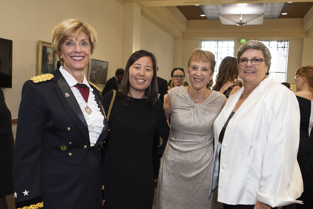 """From left, Margaret Chamberlain Wilmoth, Ph.D., MS, MSS, BSN, RN, FAAN, one of UMSON's newest Visionary Pioneers; Ruth Lee, DNP, MS, RN, president of the University iof Maryland School orf Nursing Alumni Association; Robin Newhouse, Ph.D., MS, BSN, RN, NEA-BC, FAAN, one of UMSON's newest Visionary Pioneers;  and Mary """"Meg"""" E. Johantgen, PhD, RN, associate professor and former associate dean of UMSON's doctoral program, pose for a photo. (Photo by Larry Canner)"""