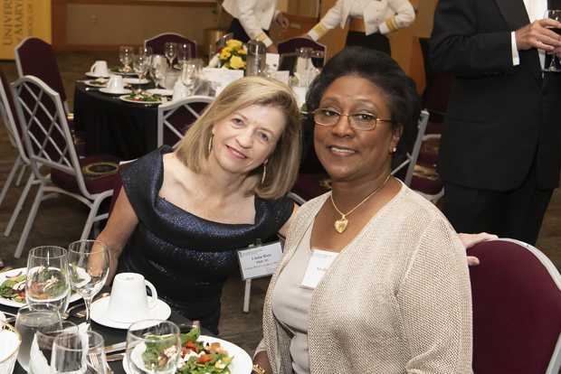 Linda Rose, Ph.D., left, and Arvella Bing enjoy their time at the University of Maryland School of Nursing;s 130th annual anniversary gala. (Photo by Larry Canner)
