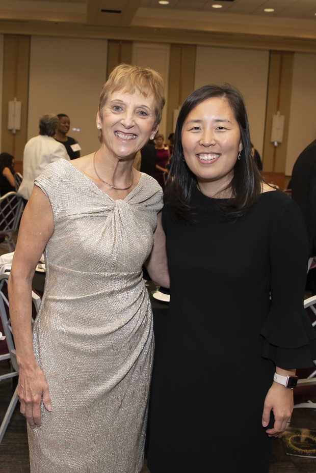 Robin Newhouse, Ph.D., MS, BSN, RN, NEA-BC, FAAN, left, one of the University of Maryland School of Nursing's newest Visionary Pioneers, gets a photo with Ruth Lee, DNP, MS, RN, president of the UMSON Alumni Association. (Photo by Larry Canner)