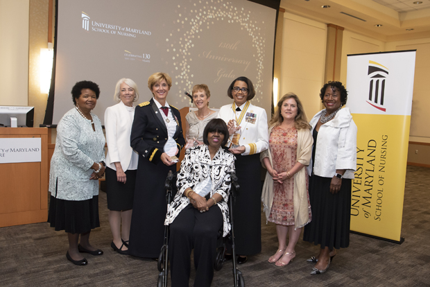 Women who were Maryland School of Nursing Inaugural Visionary Pioneers gather for a photo with some of the newest members of the group. Standing are Phyllis Sharps, Ph.D., BSN, RN, FAAN, a University of Maryland School of Nursing Inaugural Visionary Pioneer; Darlene J. Curley, MS, BSN, RN, FAAN, an UMSON inaugural Visionary Pioneer; Margaret Chamberlain Wilmoth, Ph.D., MS, MSS, BSN, RN, FAAN, one of UMSON's newest Visionary Pioneers; Robin Newhouse, Ph.D., MS, BSN, RN, NEA-BC, FAAN, one of UMSON's newest Visionary Pioneers; Rear Adm. Sylvia Trent-Adams, Ph.D., MS, RN, FAAN, FNAP, one of UMSON's newest Visionary Pioneers; Elizabeth Schuyler Niemyer, MS, BSN, an UMSON inaugural Visionary Pioneer; Pamela V. Hammond, Ph.D., ScD (Hon.), MS, RN, ANEF, FAAN, an UMSON inaugural Visionary Pioneer; Sitting, Bertha L. Davis, Ph.D., MS, RN, ANEF, FAAN; one of UMSON's newest Visionary Pioneers. (Photo by Larry Canner)