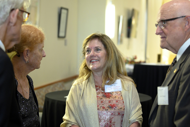 University of Maryland School of Nursing Inaugural Visionary Pioneer Elizabeth Schuyler Niemyer, MS, BSN, center, engages in conversation with, from left, Kevin O'Connell; Jeanette Jones MS; and Jack Niemyer. (Photo by Larry Canner)