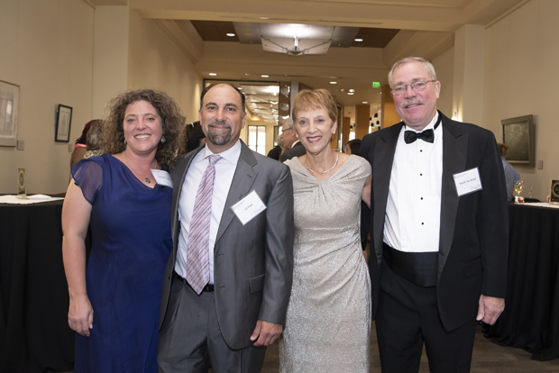 Robin Newhouse, Ph.D., MS, BSN, RN, NEA-BC, FAAN, second from right, one of UMSON's newest Visionary Pioneers, poses for a photo with Kirsten Finn, AJ Finn and Frank Newhouse. (Photo by Larry Canner)