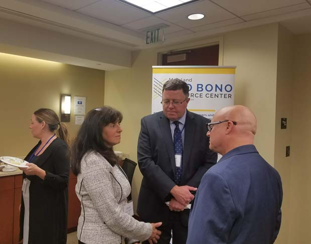 From left, PBRC Executive Director Sharon E. Goldsmith enjoys a conversation with attorneys James Connolly and Irwin Kramer of Kramer & Connolly. (Photo courtesy of Pro Bono Resource Center)