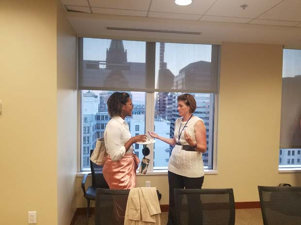 Academy Fellow Cynthia C. Farmer, left, and PBRC's Maryland Immigrant Legal Assistance Project Manager Cate H. Scenna, discuss PBRC's immigration work. (Photo courtesy of Pro Bono Resource Center)
