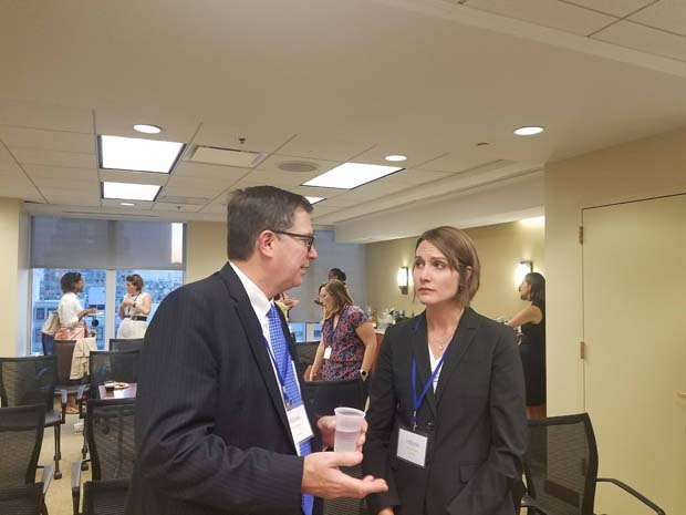 Academy mentor Gerard Vetter, Assistant U.S. Trustee for the District of Maryland, Baltimore Division in the Office of the United States Trustee in the U.S. Department of Justice, chats with Maura Ward, associate counsel with Bon Secours Health System. Vetter was paired with Ward, an Academy Fellow, as she begins PBRC's 2019-20 Professional Skills Academy. (Photo courtesy of Pro Bono Resource Center)