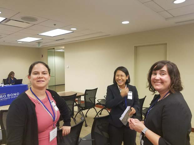 From left, Margaret Henn, director of PBRC's Home Preservation Project, Academy Fellow Angela Kuan, and PBRC Deputy Director Annie Speedie spend time chatting during the 2019-20 Professional Skills Academy kickoff event. (Photo courtesy of Pro Bono Resource Center)