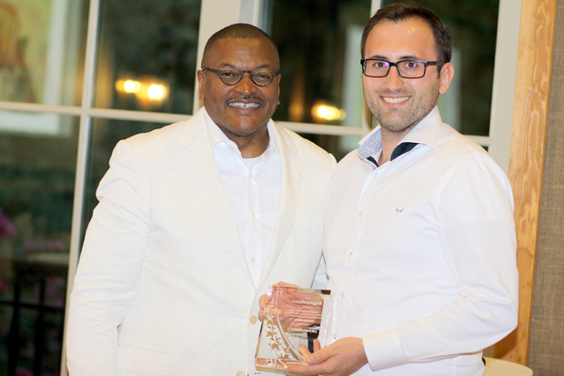 Alignstaffing founder and CEO Aaron Copeland, left, spends a moment with Sedat Akbas, a payroll accountant with the company, during the annual All-White Gala. (Photo courtesy of Alignstaffing)