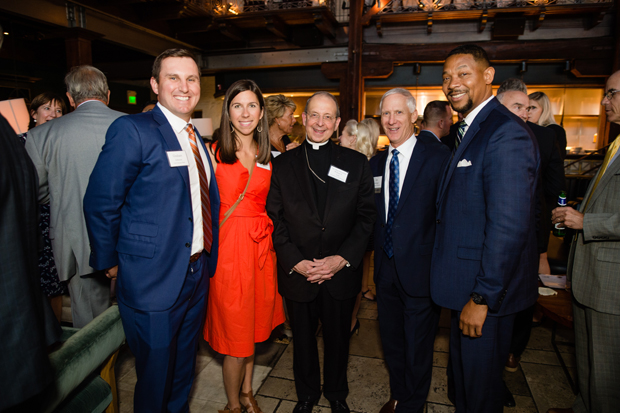From left, Graham Johnson, vice president of commercial banking at FNB Corporation; Dana Perzynski Johnson, an associate principal with architecture firm Ayers Saint Gross; the Rev. William E. Lori, Archbishop of Baltimore; Jim Sellinger, chancellor of education with the Archdiocese of Baltimore; and Franklyn Baker, president and CEO of United Way in Central Maryland, pose for a photo. (Photo courtesy of United Way in Central Maryland)