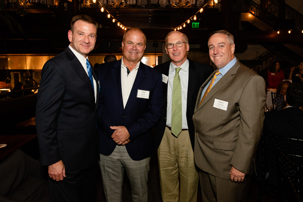 From left, Steve Woerner, president and CEO of Baltimore Gas & Electric; Mark Huston, president of Constellation Retail with Constellation, an Exelon Company; Andy Brooks, vice president of T. Rowe Price Group and T. Rowe Price Associates; and Jim McHugh, CEO of Constellation, an Exelon Company, gather for a photo. (Photo courtesy of United Way in Central Maryland)