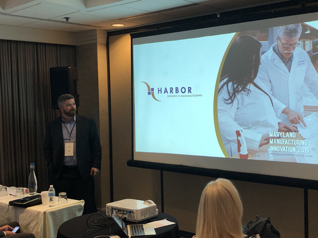 Josh Barnes, owner and chief operating officer of Harbor Designs & Manufacturing, delivers a presentation during the inaugural Maryland Manufacturing Innovation Conference. (Photo courtesy of MD MEP)