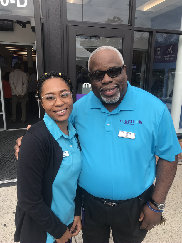 May Lewis, head teller at MECU Credit Union's new Randallstown branch, gets a photo with Philip Allen, Randallstown branch manager and director of membership services. (Photo courtesy of MECU Credit Union)