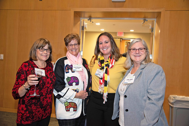 From left, Lynne Bratten, owner of Bratten Rentals LLC; Cindy Christensen, owner/director of Visiting Angels Eastern Shore; Allyson Wade, a financial adviser with Charter Financial Group; and Susan Rogers, of the Salisbury University Guerreri Student Union, pose during the event.
