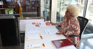 Vicki Johnson, an administrative assistant for Maryland Legal Aid, greeted visitors at the Tuesday legal clinic at the Pennsylvania Avenue branch of the Enoch Pratt library.