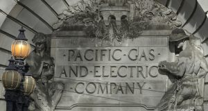 """In this photo taken Oct. 10, 2019, a Pacific Gas & Electric sign is shown outside of a PG&E building in San Francisco. A federal bankruptcy court judge on Wednesday, Nov. 27, 2019, rejected Pacific Gas & Electric's latest attempt to change a California law requiring utilities to pay for the devastation from wildfires ignited by their electrical equipment. The decision issued by U.S. Bankruptcy Judge Dennis Montali preserves a long-standing principle known as """"inverse condemnation."""" (AP Photo/Jeff Chiu)"""