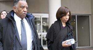 """Former Baltimore mayor Catherine Pugh, right, leaves U.S. District Court in Baltimore on Thursday, Nov. 21, 2019. An 11-count federal indictment accuses Pugh of arranging fraudulent sales of her """"Healthy Holly"""" books to schools, libraries and a medical system to enrich herself, promote her political career and fund her run for mayor. (AP Photo/Steve Ruark)"""