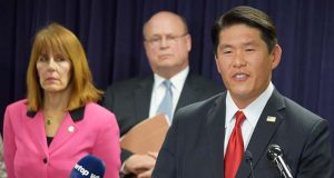U.S. Attorney Robert K. Hur announces an 11-count indictment against former Baltimore mayor Catherine Pugh on Wednesday. At left is Baltimore Inspector General Isabel Cumming; Behind them is Assistant U.S. Attorney Martin Clarke, who leads the fraud and corruption section for the U.S. Attorney's Office in Baltimore. (The Daily Record / Bryan P. Sears)