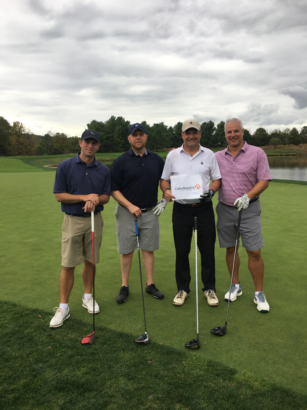 From left, Brian Kasabula, Kris Wojciechowski, Greg Pearson and Adam Kleeman take time from the golf course for a photo. (Photo courtesy of American Cancer Society)