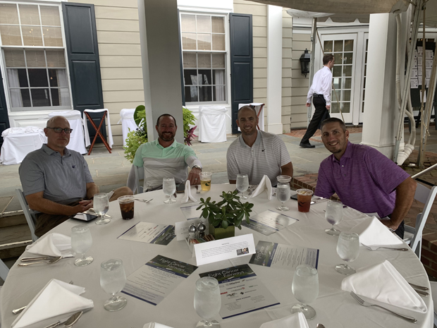 From left, Charles Bartlett, Sean Sylvester, Brock King and Anthony DiGiorgio get ready for dinner at Caves Valley Golf Club during the American Cancer Society's annual Fight Cancer From the Fairways golf tournament fundraiser. (Photo courtesy of American Cancer Society)