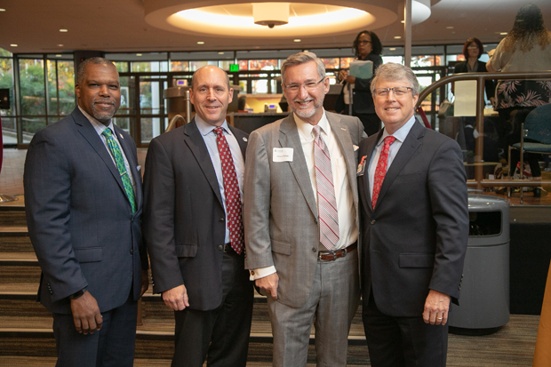 From left, Leonardo McClarty, president of Howard County Chamber of Commerce; Larry Twele, CEO of Howard County Economic Development Authority; Chuck Phillips Jr., senior vice president of KCI Technologies Inc.; and Steve Snelgrove, president of Howard County General Hospital, pose for a photo. (Photo courtesy of Howard County General Hospital)