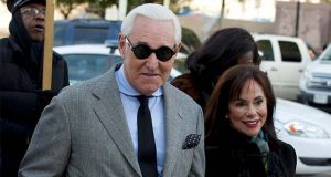 Roger Stone accompanied by his wife Nydia Stone, right, arrives at federal court in Washington, Thursday, Nov. 14, 2019. (AP Photo/Jose Luis Magana)