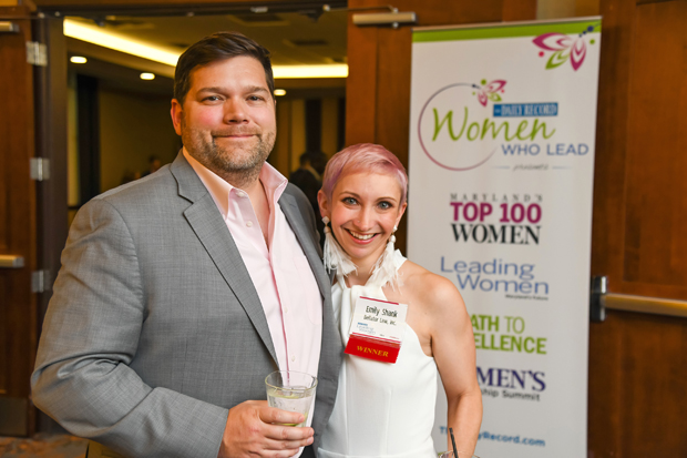 2019 Leading Women winner Emily Shank, right, a principal with law firm Bellator Law Inc., gets a photo with Mark Shank. (Photo by Maximilian Franz)