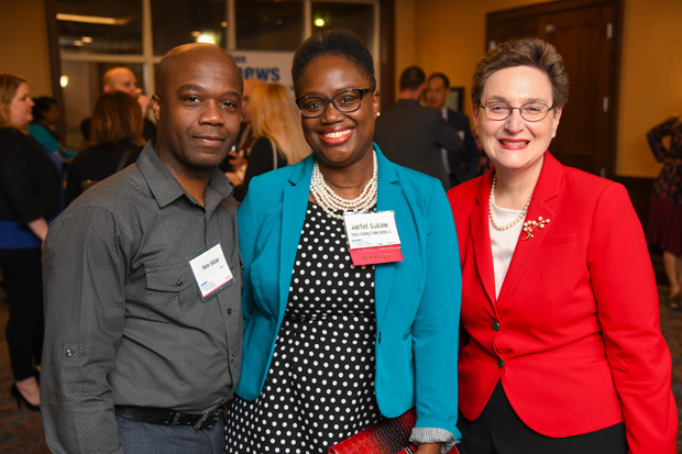 2019 Leading Women winner Rachel Dolcine, center, CEO of Compass Consulting and Training Solutions LLC, stands with Pierre Dolcine and Theresa Wiseman, President of MediWise Inc. (Photo by Maximilian Franz)