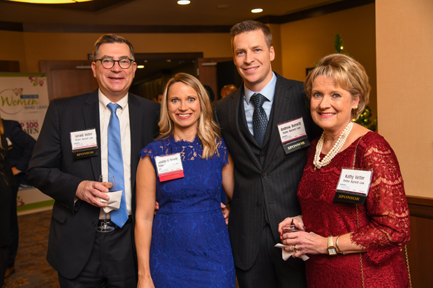 2019 Leading Women winner Suzanne V. Burnett, a partner with law firm Potter Burnett Law LLC, second from left, stands with Gerard Vetter, Andrew Burnett, Suzanne's husband, and Kathy Vetter. (Photo by Maximilian Franz)