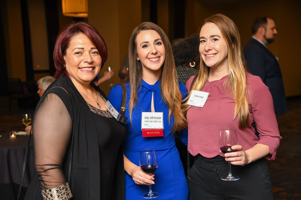 2019 Leading Women winner Ashley Smith Rosenblatt, an adjunct professor with Community College of Baltimore County, center, stands with Claudia Castro, human resources director at Ridgewells Catering, left, and Kristen Ferraro. (Photo by Maximilian Franz)