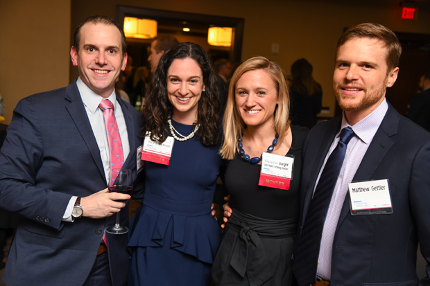 From left, Glenn Gordon, an associate with law firm Miles & Stockbridge P.C.; 2019 Leading Women winner Sara Rose David, senior assistant in the Office of the State Prosecutor; 2019 Leading Women winner Elizabeth Burger, senior director of strategic initiatives with Johns Hopkins Technology Ventures, and Matthew Gettier, take time for a photo. (Photo by Maximilian Franz)