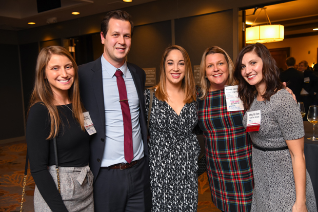 From left, Mallory Finn, a staff attorney with Project HEAL at Kennedy Krieger Institute; Joel Thorn; 2019 Leading Women winner Alyssa Navarrete Thorn, a staff attorney with Project HEAL at Kennedy Krieger Institute, past Leading Women and Top 100 Women winner Maureen van Stone, Director of the Maryland Center for Developmental Disabilities at Kennedy Krieger Institute, and 2019 Leading Women winner Ashley Van Stone, executive director of Trash Free Maryland, pose for a photo. (Photo by Maximilian Franz)
