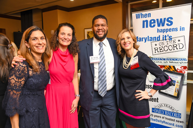 2019 Leading Women winner Pilar Camus Nichols, a principal with law firm Offit Kurman P.A., far right, joins former Leading Women winner Jessica Quincosa, executive director of Community Legal Services for Prince George's County; Suzanne Fischer-Huettner, publisher of The Daily Record; and William Carl Isler, program counsel with Legal Services Corporation. (Photo by Maximilian Franz)