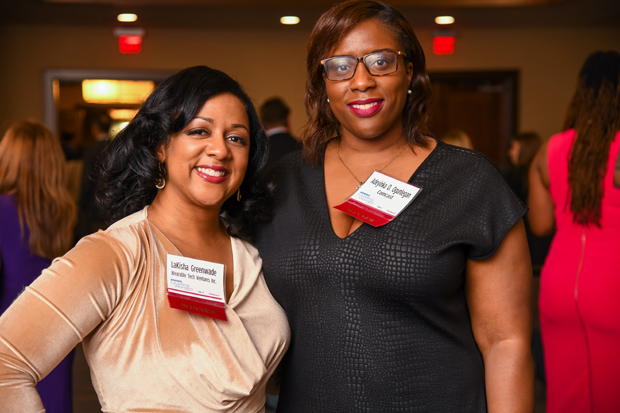 2019 Leading Women winners LaKisha Greenwade, founder of Wearable Tech Ventures Inc., and Adeyinka O. Ogunlegan, senior manager of government and regulatory affairs with Comcast, pose for a photo. (Photo by Maximilian Franz)