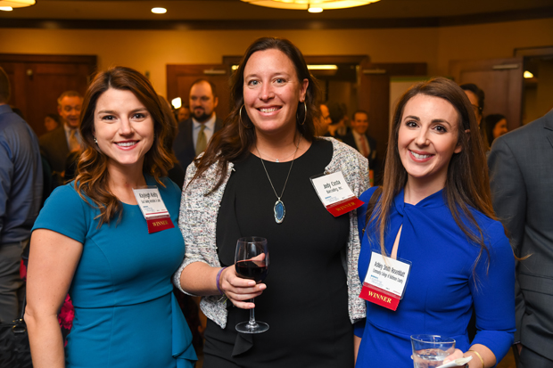 From left, 2019 Leading Women winners Kayleigh Keilty, an associate with law firm Saul Ewing Arnstein & Lehr; Jody Costa, vice president of marketing with Barcoding Inc.; and Ashley Smith Rosenblatt, an adjunct professor at Community College of Baltimore County, enjoy their awards. (Photo by Maximilian Franz)