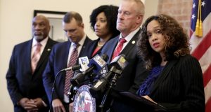 Maryland State Attorney Marilyn Mosby, right, speaks during a news conference announcing the indictment of correctional officers, Tuesday, Dec. 3, 2019, in Baltimore. Twenty five correction officers, most of whom were taken into custody earlier in the day, are charged with using excessive force on detainees at state-operated Baltimore pretrial correctional facilities. (AP Photo/Julio Cortez)