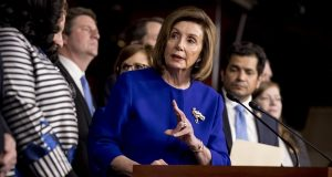House Speaker Nancy Pelosi of Calif., accompanied by House Congress members speaks at a news conference to discuss the United States Mexico Canada Agreement (USMCA) trade agreement, Tuesday, Dec. 10, 2019, on Capitol Hill in Washington. (AP Photo/Andrew Harnik)