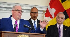 Gov. Larry Hogan announces his education agenda Thursday as Lt. Gov. Boyd Rutherford, center, and Secretary of Budget David Brinkley look on. (The Daily Record / Bryan P. Sears)