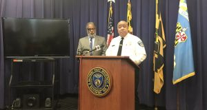 Baltimore City Solicitor Andre Davis, left, and Police Commissioner Michael Harrison discuss the new pilot surveillance plane program. (The Daily Record/Louis Krauss)