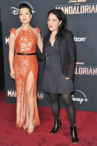 """This Nov. 13, 2019 file photo shows actress Ming-Na Wen, left, and director Deborah Chow at the premiere of """"The Mandalorian"""" in Los Angeles. Chow directed an episode of the popular Disney Plus series. (Photo by Richard Shotwell/Invision/AP, File)"""