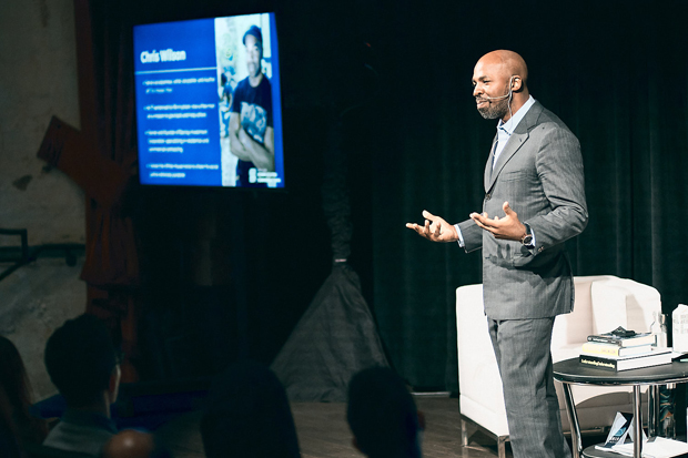 """Chris Wilson, a former prison inmate and author of """"The Master Plan,"""" speaks to the more than 175 business leaders during SHIFT U: Complicated Conversations. (Photo courtesy of SHIFT Society)"""