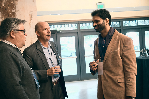 Pritpal Kalsi, right, the director of SC&H Group, chats with Paul Palmieri, left, managing general partner and founder of Grit Capital Partners, and Jim Witty, senior vice president and regional revenue officer for SIG. (Photo courtesy of SHIFT Society)