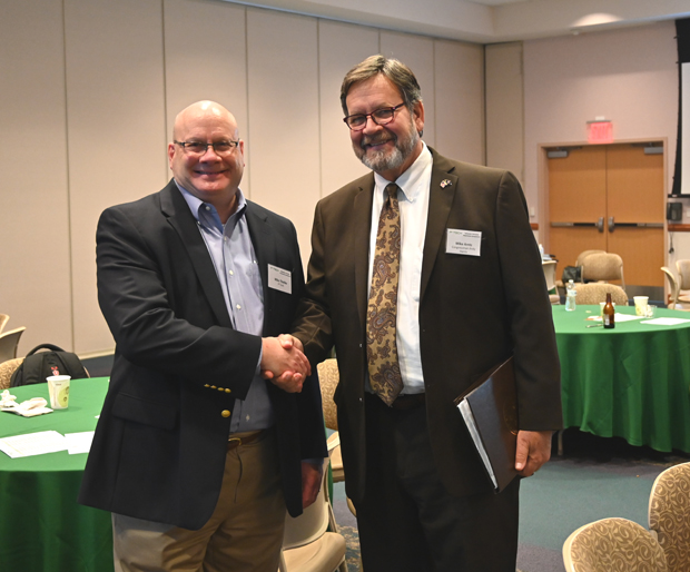 Mike Thielke, left, executive director at the Eastern Shore Entrepreneurship Center and Mike Arntz, community liaison for Rep. Andy Harris, R-Md., shake hands at the F³ Tech symposium. (Photo courtesy of F³ Tech Accelerator)