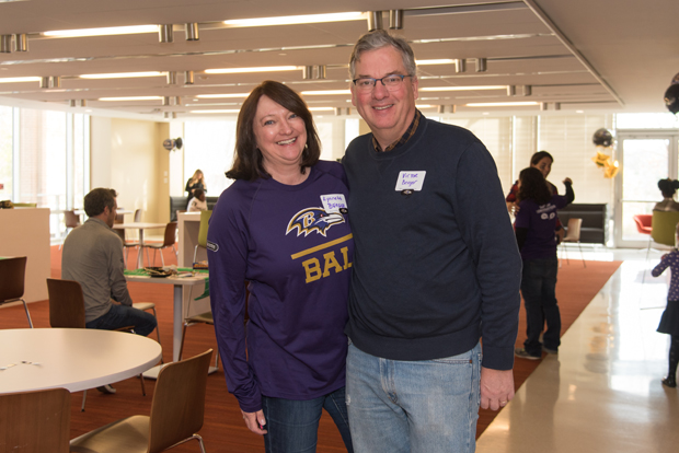 Lynette Berger, a senior program manager at T. Rowe Price, and Victor Berger, an attorney at Berger & Burns LLC, enjoyed the festivities at the Ravens watch party. (Photo courtesy of T. Rowe Price)