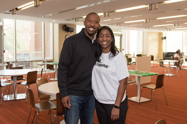 Matt Lawrence, a former member of the Baltimore Ravens, poses with Watikqua Lange, program manager at T. Rowe Price. (Photo courtesy of T. Rowe Price)