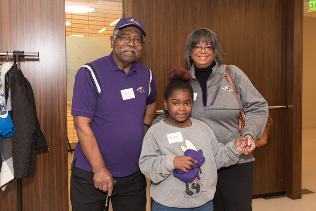 Bill Lupton, a retired professor from Morgan State University, and Monica McKinney Lupton, director of the Murphy Fine Arts Center; pose for a photo with their granddaughter, Milani. (Photo courtesy of T. Rowe Price)